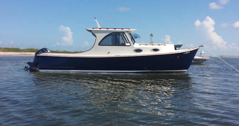 A newly completed 26' picnic boat-style outboard cruiser, on picnic trials